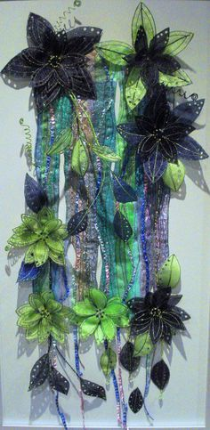 Kathleen Laurel Sage uses machine embroidery, organza fabrics, water soluble and a soldering iron to make vases, floral panels and fashion items. Applique Wall Hanging, Quilted Wall Hangings, Textile Fiber Art, Textile Artists, Water Soluble Fabric, Creation Crafts, Fabric Bowls, Creative Textiles, Fabric Wreath