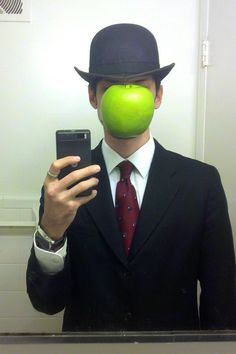 A plastic apple plus a bowler hat make The Son of Man. | 21 Unusual Halloween Costumes You Can Make Yourself