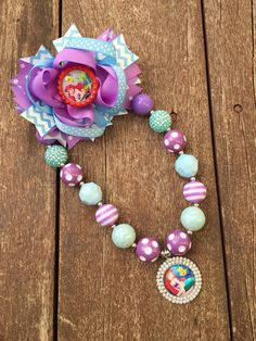 This is for 1 Bubble Gum Chunky Necklace  Little Mermaid Chunky Bubble Gum Necklace  1 Little mermaid hair bow  Perfect For a birthday or photo prop…Every little girl looks to accessorize..Makes a cute Piece..  All items come from a pet free/ smoke free home. Items will ship between 7-10 business days and will be shipped USPS.  ADULT SUPERVISION IS REQUIRED WHENEVER CHILDREN WEARING THESE ACCESSORIES..THEY CONTAIN SMALL PIECES…  Thank you for visiting Camdyn Reese Headbands! Perfect…