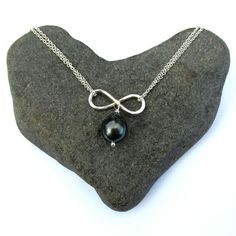 A personal favorite from my Etsy shop https://www.etsy.com/listing/224495626/tahitian-pearl-infinity-necklace