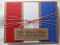 handmade card ... perfect for the Fourth of July ... red, white and blue on kraft card base ... panels of solid color embossed with stars embossing folder ... wrapped several times and tied up with baker's twine hanging the sentiment ... good design for a quick card ...