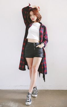 Longline flannel shirt, white crop top, leather shorts, black converse.