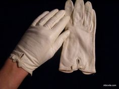 1950s Vintage white leather hand gloves.  I still have my white leather gloves.  We always wore gloves and our hats when we went to church or to shopping in the city.