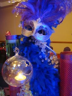 masquerade centerpiece. Love the hanging candle!!