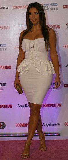 Kim Kardashian pours her curves into a tight white dress after saying she'll lose weight