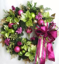 Thanks so much for stopping by and visit my creations. All my wreath is unique and created in highest quality. You will enjoy them in many years to come. This beautiful Christmas Holiday Lime Green and Pink flower door wreath sets on a 24 Christmas Pine Wreath base.    The wreath is embellished with beautiful magenta Poinsettias, lime green Poinsettias, sparkle gold and lime green Christmas Berries, and lime green/magenta Christmas ornaments. The wreath is accented with a lime green/magenta…