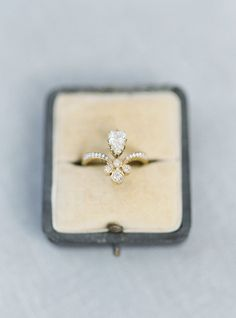 Eccentric fleur de lis-esque engagement ring: http://www.stylemepretty.com/little-black-book-blog/2015/12/04/charming-french-estate-wedding-inspiration/ | Photography: Jake and Heather - http://jakeandheatherphoto.com/