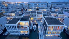 NETHERLANDS, AMSTERDAM, IJBURG. Built over a number of artificial islands which have been raised from the IJmeer lake. The ambitious project is still under construction, but more than 20,000 people have already moved in. When complete, the neighbourhood will have 18,000 homes for 45,000 residents as well as schools, shops, leisure centers, restaurants, and beaches. One of its many innovative housing projects is taking place in Waterbuurt or Water District.