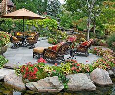We have some big rocks in the woods we could use like this around our patio. Relaxing Backyard Ideas