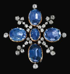 SAPPHIRE AND DIAMOND BROOCH designed as a cross, set with oval sapphires and circular-cut diamonds