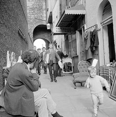 Busiest boy in Dublin Love this photo for its glimpse of an old, old thoroughfare in Dublin - Merchant's Arch - its shopkeepers, customers, wares and passersby. But it is the little boy who draws the eye. If ever there was a child on a mission, it's surely him! 1969