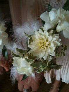 White #dahlias work well for corsages..Add a touch of feathers for a fun and funky look #growingwildfloral.com #dcweddings