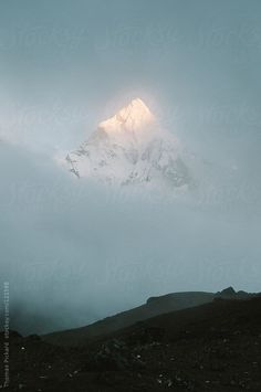 Cloud and mountain, Everest Region, Sagarmatha National Park, Nepal. by Thomas Pickard