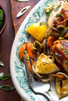 NYT Cooking: A chile-flecked, honey-imbued marinade spiked with fresh citrus juice gives this chicken its fiery, syrupy character. Dates and carrots give the sauce texture and additional sweetness while a garnish of fresh herbs and pistachio nuts lends freshness and crunch. It's dinner party food at its most flavorful and convenient