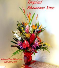 LARGE TROPICAL SHOWCASE VASE- Click to enlarge-  36 inches tall 24 inches across. $189.99   A fragrant lovely assortment of our freshest Hawaiian flowers. This arrangement screams out Hawaii. All of these flowers are grown in our lovely islands. This product is available for West Maui delivery or Pick Up only. Please call 808-661-3455