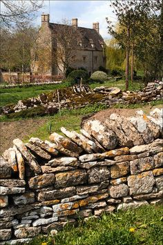 Aldsworth Stone Wall  in the village  of Aldsworth, Gloucestershire, England by Steve