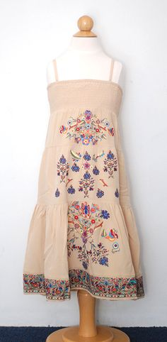 This gorgeous bohemian dress from Native Funk & Flask is a Sophi Blu favorite. Maxi dress length, this dress features hand embroideryalong the front of the dress. Ruched across the check, this dress is perfect for summer.