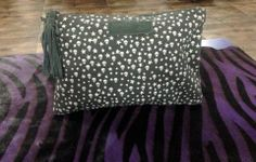 Step in the world of magical clutch bags! Grey canvas clutch with all over stars and skulls print and suede pom pom. Size: 20 cms x 29 cms Price: Rs 2000 For details of the products and to place an order, you can whatsapp on 9999968917, +34630292108 or email at veralikasingh@hotmail.com or maddy_rawat@hotmail.com.