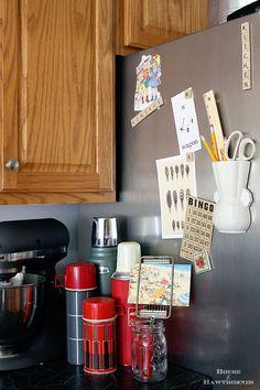 Vintage wall pocket used as a refrigerator organizer - from houseofhawthornes.com