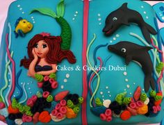 Mermaid & Dolphin cake exactly what Lilly wants but in a much more thought out put together cake.