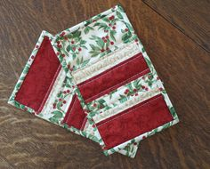 Quilted Christmas Mug rug set of 2 in holly by WarmandCozyQuilts
