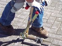Pavetech Paverextractor - Just set the opening between the teeth for the paver to be extracted and squeeze the handles together.  The locking device will keep constant pressure on the paver, making it easier for the operator to rock & lift the paver out.