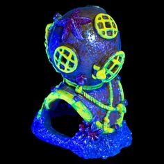 GloFish Diver Helmet Ornament http://www.thatpetplace.com/glofish-diver-helmet-ornament?utm_content=buffer9e9a7&utm_medium=social&utm_source=pinterest.com&utm_campaign=buffer   Glo Fish Ornaments are flashy and colorful ornaments that give your fish a place to take a quick break from the rest of your aquarium! The special exterior finish offers an attractive glowing aura when placed under a Glo Fish LED light fixture! Adds a unique appearance to your aquatic decor!