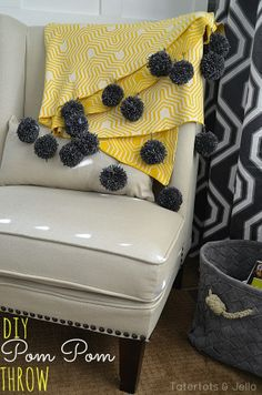 Fall is the perfect time of year to DIY a cozy pom pom throw! From Tatertots and Jello.