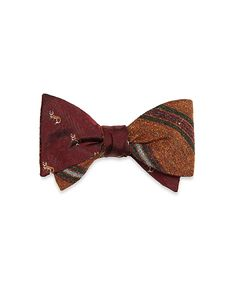 This bow tie is crafted from pure silk jacquard. Self-tie with either side facing out. Dry clean. Made in the USA.