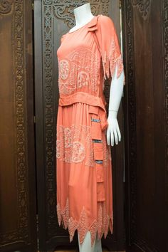 1920s Pink Beaded Dress Salmon pink mid-late 1920s dress is hand-beaded with handkerchief sleeves and hem and a silk velvet side flounce Decades of Fashion Side 2