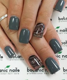 Winter laces nail art design. Paint your nails in matte dark green colors and decorate the nails on the ring fingers with beautiful lace patterns.