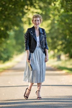 Pleated silver skirt and biker jacket  For more fashion and outfits go to : myfuntasticlife.com