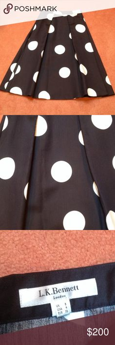 L.K. Bennett Polka Dot Midi Skirt SZ 4 A chic and fun skirt that is guaranteed to turn heads! Navy blue with white polka dots. Pleat detail adds fullness to this playful skirt. Pair with a cami or cropped sweater! LK Bennett Skirts Midi