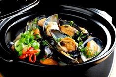 This Thai mussel recipe makes an incredible appetizer, or add a salad and enjoy as the main course. Fresh mussels are steamed in white wine, then briefly simmered in a basil and coconut sauce. The dish is finished off with a sprinkling of fresh red chillies, coriander, and more basil for a seafood dish that is easy to make but tastes truly gourmet! Excellent with your favorite wine.