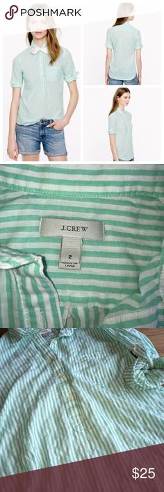 """J. Crew Camp Popover Tunic mint green stripe. J. Crew Camp Popover Top with white and mint green stripes! Part tunic and part button down! Cool, casual and cute! Lightweight and soft cotton material with roll up button tab sleeves. Can be worn with sleeves up or down. Pre loved but in like new condition. No rips, tears, stains or holes! Laying flat..total length is 25"""" in he front and 27"""" in the back. J. Crew Tops Button Down Shirts"""