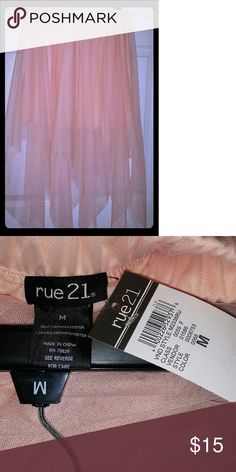 Pink tulle skirt The skirt has long peaks and its a light pink Rue 21 Skirts Asymmetrical