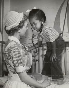 Cute little girl, a pediatric patient, tries out a stethoscope on a nurse at Bellevue Hospital, ca. From the Department of Public Charities and Hospitals Collection, NYC Municipal Archives Bellevue Hospital, Nursing Fields, Flight Nurse, Community Nursing, Nursing Profession, Male Nurse, City Government, Vintage Nurse, Pediatric Nursing