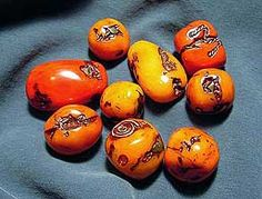 My collection of faux amber, primarily using Cernit translucent that I tinted with clay and/or stained with inks. This version mimics antique African amber beads where some were decoratively repaired with wire and enhanced with turquoise chips.
