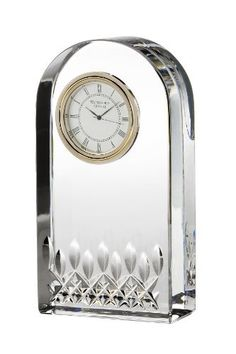 The new desk collection offers the perfect gift for any celebration in corporate life from a new hire or a career advancement. This simple streamlined clock holder carries the signature Lismore essence cutting pattern and is sophisticated with enduring elegance.