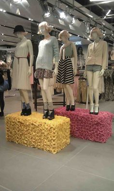 Topshop   Love the flower covered pedestals the mannequins are standing on