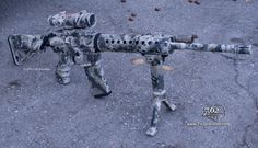 "AR-15 duracoated in ""Cypsis"" camo"
