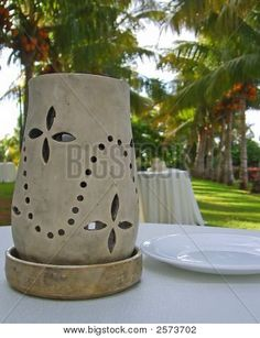 Clay Lantern On Table In Tropical Setting | Stock photo