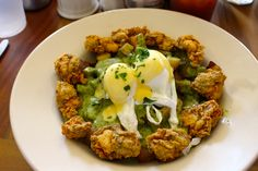Oysters Florentine at Elizabeth's - Creamed Spinach, Fried Oysters over Potatoes, Topped with Poached Eggs and Hollandaise