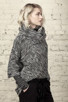 Cute sweater. I like the interesting way the seams are angled and the black and white fabric.