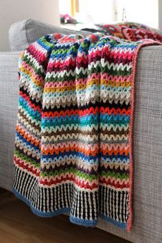 MAKE YOUR OWN SCRAPPY HAPPY V-STITCH BLANKET with this Step-By-Step crochet pattern written in US, UK and Swedish terms. It might look like just a