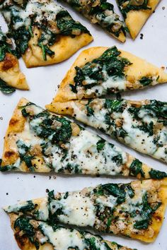 This Saag Paneer Pizza tops our list of quick and easy dinner recipes! Naan bread is the FASTEST and cheapest shortcut to weeknight pizza we know. Customize to suit your flavors, but we like to use spinach, garlic and mozzarella for this indian-food inspired pizza.