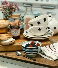 Gant homes are always gorgeous and brilliantly designed: Patterned kitchenware, rustic wood, flowers & preserves, and delicious food.