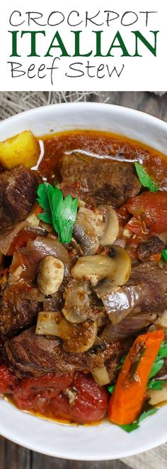 Crock Pot Italian Beef Stew Recipe | The Mediterranean Dish. This is a family favorite! Beef stew that's been slow cooked to tender perfection in a special wine broth with loads of carrots, mushrooms and aromatics. Packed with flavor from garlic, onions, and fresh herbs. Best part, it takes only 15 minutes to prep, and the crock pot does all the heavy lifting. This is the prefect beef stew! A must-try from http://TheMediterraneanDish.com