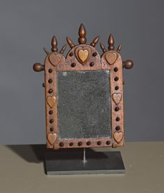 "Miniature Mirror - Label on reverse side reads, ""Made by hand by William Whitaker"" 1862 W.C.B.E."""