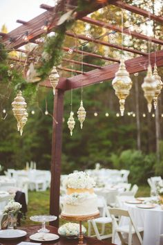 hanging reception decor - photo by Kelly Maughan Photography http://ruffledblog.com/north-carolina-wedding-sourced-from-antique-shops #weddingideas #caketable #desserttable